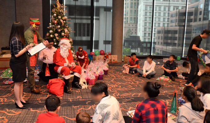 Santa And His Elf Going Through The Christmas List